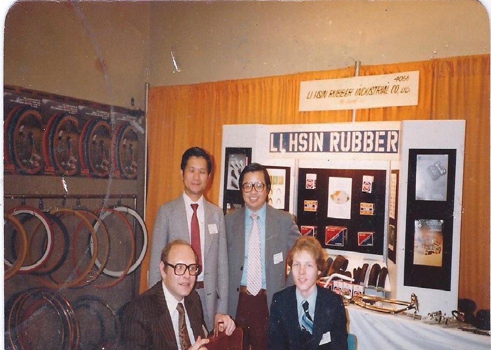 Bob Fluhr, bottom left, with son Steven at the 1980 New York bike show. The man standing on the left is Mark Lsai, the owner of Li Shin Rubber.