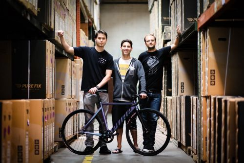 Fishman (center) is president and co-founder of Pure Cycles.