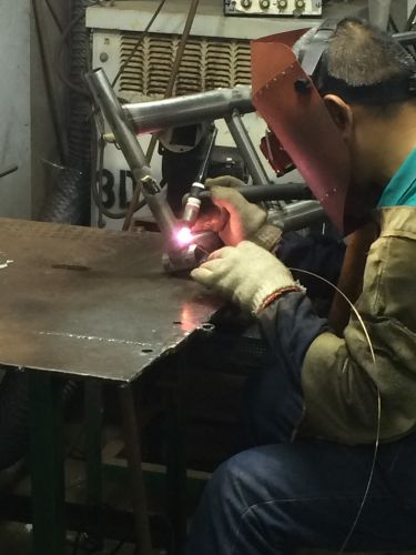 A welder at a Taiwanese bike factory. BRAIN photo.