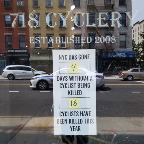 718 Cyclery owner Joe Nocella has a new sign in his window.