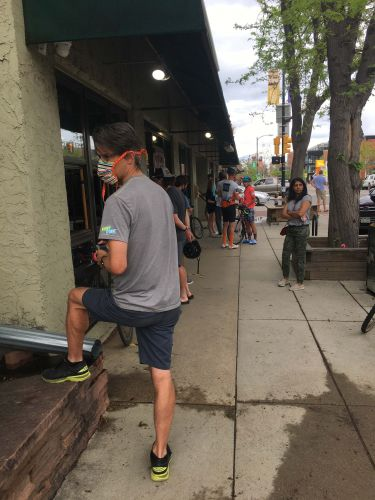 Customers wait outside University Bicycles in Boulder this week.
