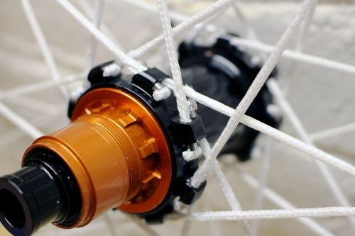 The Berd spokes work with hubs designed for J-bend or straight-pull metal spokes.