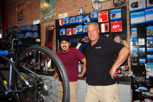 Epic Cycles owner Allan Hightower, right, with mechanic Alonso Gutierrez.
