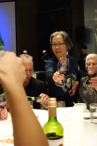 Stella Yu toasts guests at the 2019 Velo/Wellgo/Prologo dinner.