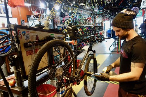 University Bikes' Michael Pope prepares to wipe down a service bike on Sunday. BRAIN Photo.