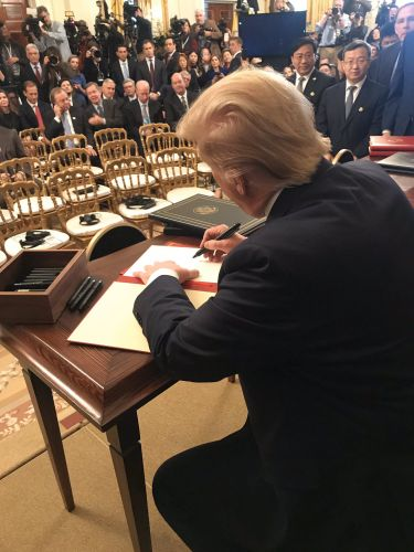 White House photo of Trump signing the agreement Wednesday.
