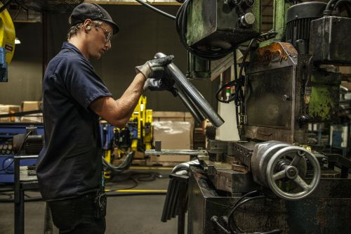 A worker builds a Saris trainer at its Wisconsin factory. Saris photo.