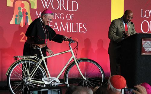 The Archbishop received the bike on behalf of Pope Francis.