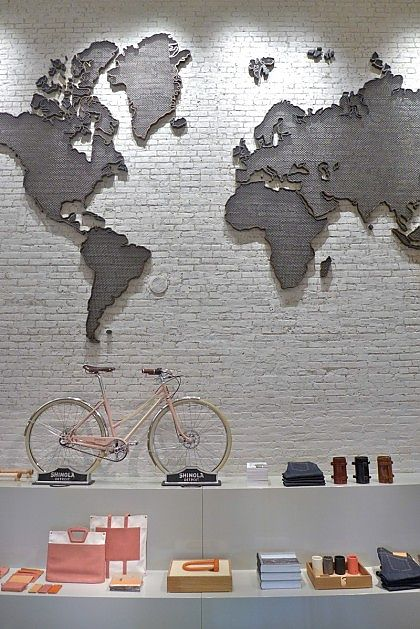 Detroits shinola opens retail boutique in manhattan bicycle a 1930s world map sculpture hangs over a shinola city bike gumiabroncs Images