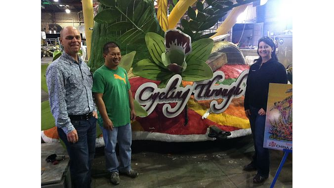 Brad Klipping, Giant USA Marketing Manager (far left) and Benson Lam, owner of Jones Bicycles II in San Marino, CA, get a sneak-peek of the China Airlines float before the 2013 Rose Parade.  On the right is Giant USA Marketing Project Manager Deanne Wilson, who organized the bicycles and riders who will pedal Giant and Liv/giant bicycles alongside the float.