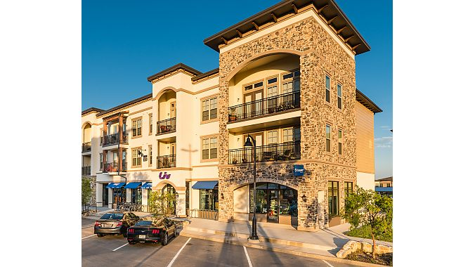Outside Giant Lakeside in Flower Mound, TX. The business occupies the ground floor in one of the upscale residential/commercial spaces in The Shops at Lakeside.