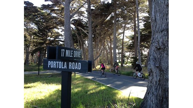 Cyclists cruise down the Monterey Coast's scenic 17 Mile Drive on Wednesday during an industry ride for both the BLC and IBD Summit.