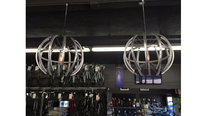 The store designer at I. Martin chopped up rims to make these chandeliers and hung them with bike chains above the cash wrap at the front of the store.