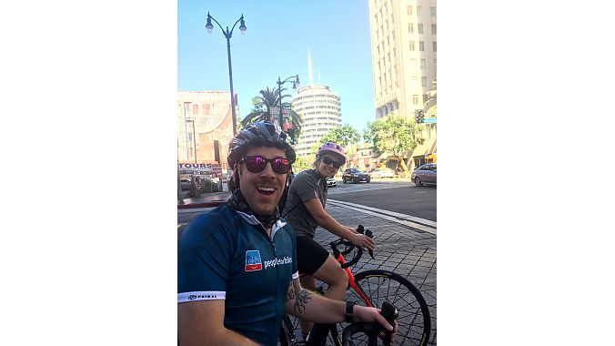 The ride down Hollywood Boulevard took PeopleForBikes' Mitch Marrison and BRAIN features editor Val Vanderpool past the landmark Capitol Records building (background) in Hollywood.