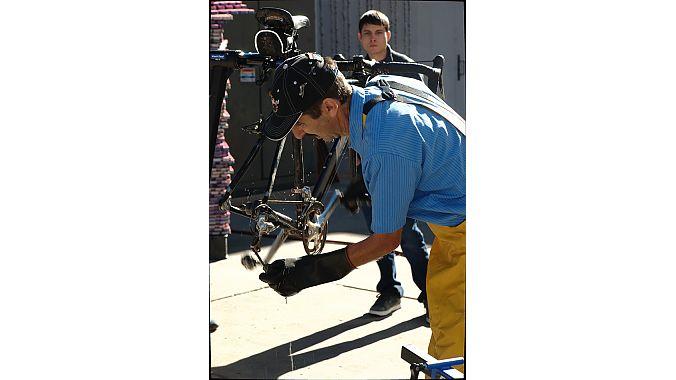 Jones goes over bike cleaning technique.