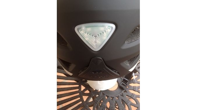 "The rear of Abus' Pedelec helmet features a light with three setting plus a compartment for a helmet ""rain cape."""