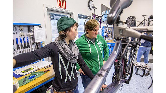 B Vivit (left), a QBP Women's Bike Mechanic Scholarship winner, attended UBI in early 2017.