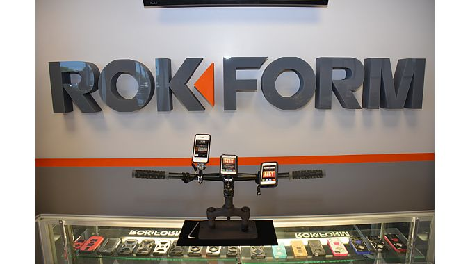 A point-of-purchase display demonstrates handlebar mounting options for Rokform's phone cases.