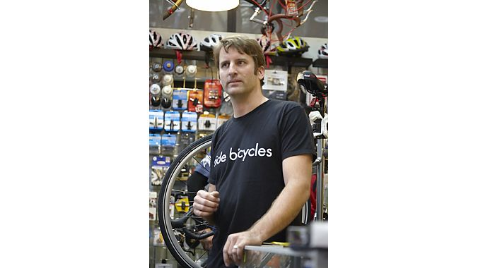"Ride Bicycles owner Christian Bourdrez gets a lot out of a modest space at his transit-focused shop. With a storefront of just 450 square feet, he has to make sure that what he stocks moves out the door quickly. That means carefully selecting product and reordering every two or three days to keep the shelves lined. Bike lines include Surly, Public, Raleigh, Torker and Xtracycle cargo rigs—all aimed at commuters, street riders and ""grocery getters,"" said Bourdrez. His average bike sale comes in around $900,"