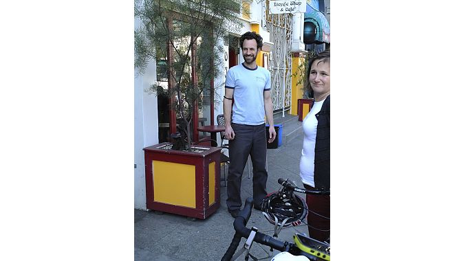Good times in front of Mojo Bicycle Cafe with owner Remy Nelson and the coalition's Leah Shahum