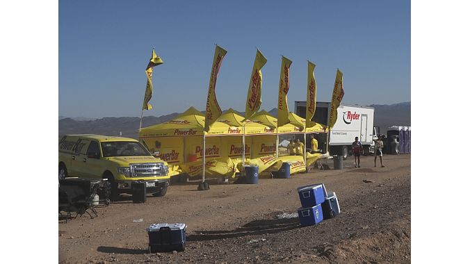 Late-day wind ripples the flags at PowerBar's trail-side tent.