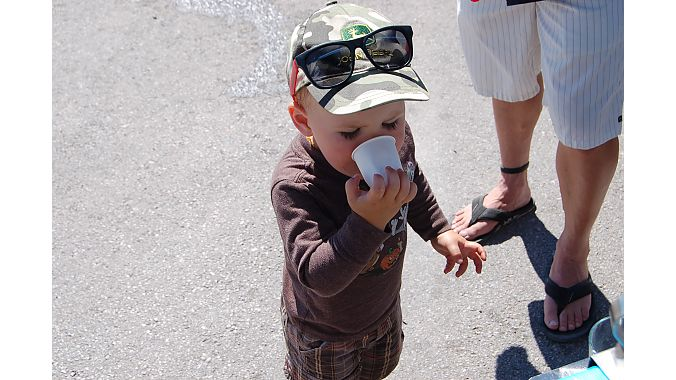 Start 'em early. A tot hydrates with an Osmo Nutrition drink Monday at Outdoor Demo. Photo: Nicole Formosa