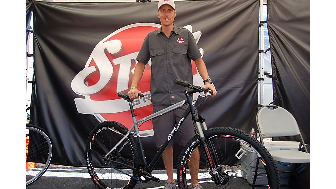 Spot's Andrew Lumpkin shows the new Honey Badger steel 29er with Gates' Carbon Drive belt system. Spot returned to Outdoor Demo after a six-year absence with a demo fleet of about 14 Badgers. Spot ponied up $6,000 to fly the bikes from its Asian factory to make sure they made it across the Pacific in time for this week's show. Photo: Nicole Formosa