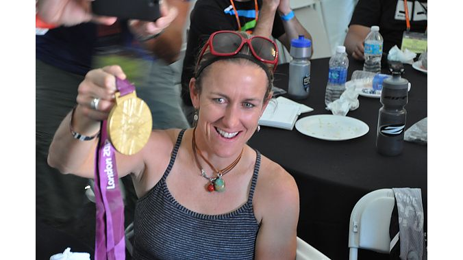 Olympic gold medalist Kristin Armstrong shows off her medal after the SRAM-Zipp-Quarq Tuesday Morning Ride. Photo: Jill Janov