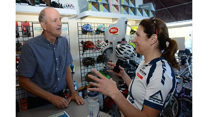 Mangrove Cycles owner Bill Durham reminisced with ASI's Karen Bliss, who once won a big road race that Durham used to produce.