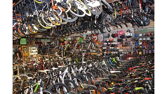 No Boundaries Sport has some of the most innovative merchandising and display fixtures we've seen, and they are nearly all made of recycled and repurposed materials, from old chainrings to hurricane shutters and road signs. The shop also packs an enormous amount of inventory into a tight space.