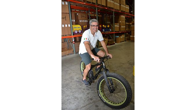 No Boundaries Sport owner Nico Stasi tries a fat bike in J&B Importers' warehouse Tuesday evening.