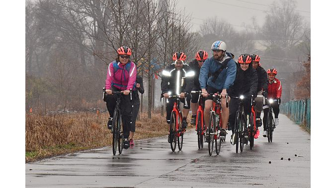 A wet but happy crew on the road.