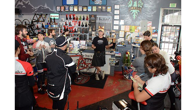 Outback Bicycles' Pete Wicker, in his trademark kilt and fox hat, relates his store's history.