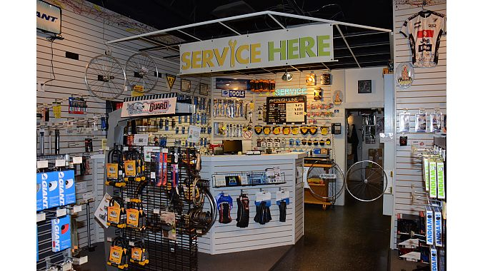 Bicycle South's service area has an interesting wheel swinging door.
