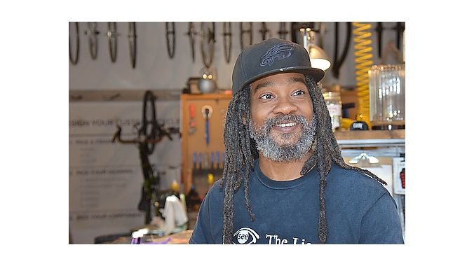 Shop and bar manager Dread Fiyah also does drafting work for The Spoke Easy owners' architectural design business, Cluck Design Collaborative, housed in the same building.