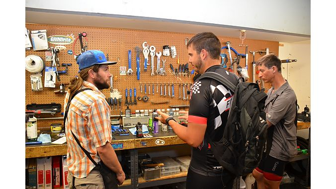 Goltz chats with the Sports Den's mechanic about new Finish Line products.