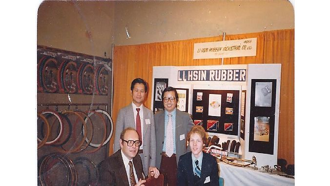 Bob Fluhr, bottom left, with son Steven at the 1980 New York bike show. The man standing on the left is Mark Tsai, the owner of Li Hsin Rubber and the other man is Joe Hwang, then the sales manager for LHR USA.