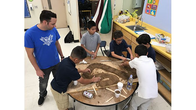 Students get their hands dirty in the USA BMX Foundation's Track Modeling Program, which has helped draw new participants to the BMX Racing League.