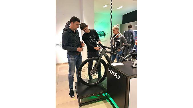 Dominik Geyer (middle), Specialized's Turbo product manager, talks battery life and other details with customers in the new pop-up store.