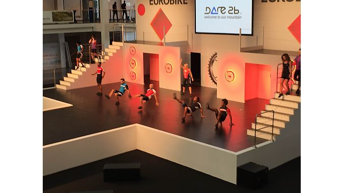 Dancers rehearse for the Eurobike Fashion Show, a longtime fixture at the trade exhibition.