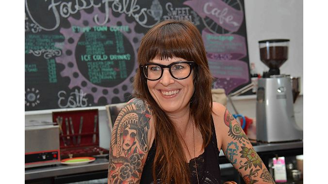 Natalie Goforth opened Fast Folks Cyclery in 2009 and moved to the shop's current location downtown in July. The shop/café has become a social hub, and Goforth plans to expand her footprint to host bigger events and increase her retail space.