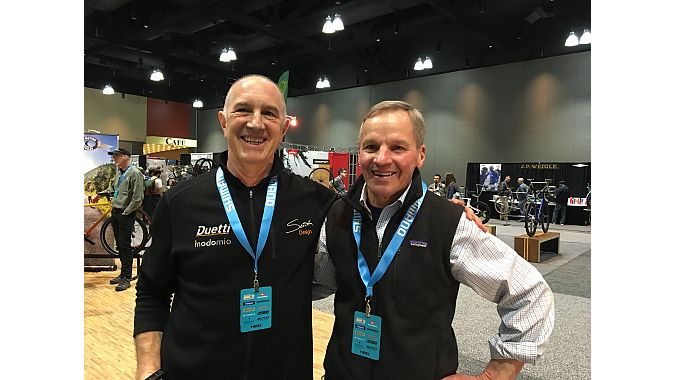 Former colleagues and old friends Ben Serotta and Peter Weigle, took a few moments to catch up between meeting prospective clients.