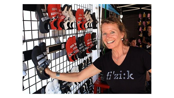 Fizik's Suzette Ayotte demonstrates the company's velcro shoe display system. Ayotte kept busy Monday helping sell 2012 model year shoes to retailers.