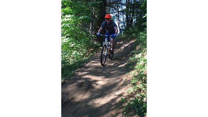Kingdom Trails boasts more than 100 miles of mountain bike terrain across 62 privately owned lands. The trail system, located in Vermont's Northeast Kingdom, has become a renowned mountain biking destination.