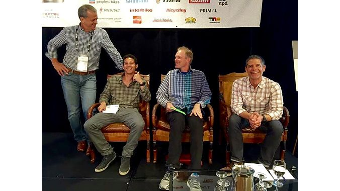 Moderator Pat Hus (left), and panelists (L-R) Michael Fishman of Pure Cycles, Erik Saltvold of Erik's Bike and Board, and Columbia Sportswear's Russ Hopcus, all showed up in plaid for Thursday's omnichannel panel discussion. Photo by Ray Keener.