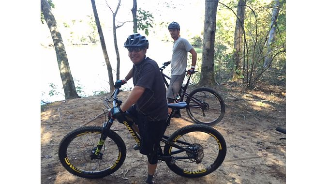 Bill Rudell (foreground) and Alex Sandella of CycloFest exhibitor G-Form take a lakeside break on the trail network at the U.S. National Whitewater Center.