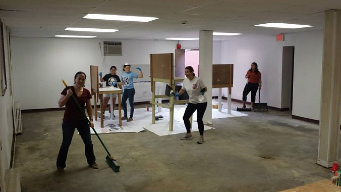 Volunteers build six workbenches that will be available for use in the community shop.