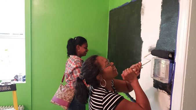 As a nonprofit, Gearin' Up has a large army of volunteers to keep things running. Here, volunteers help paint the new space.