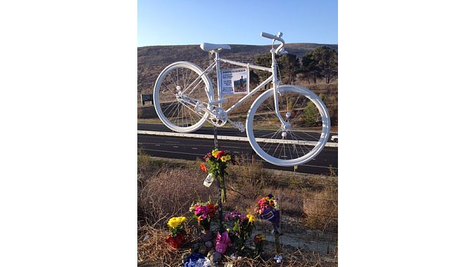 "Jax Bicycle Center, where Robinson worked, put up this ""ghost bike"" on Santiago Canyon Road in his memory."