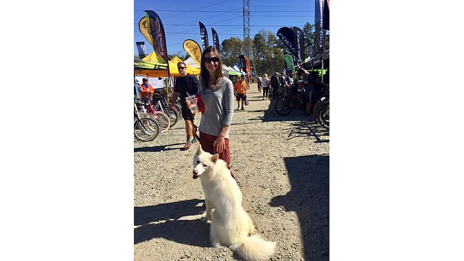 Beginner mountain biker Angela Greenwell traveled from Atlanta with her dog Beso to scope out Cyclofest and look at helmet options.